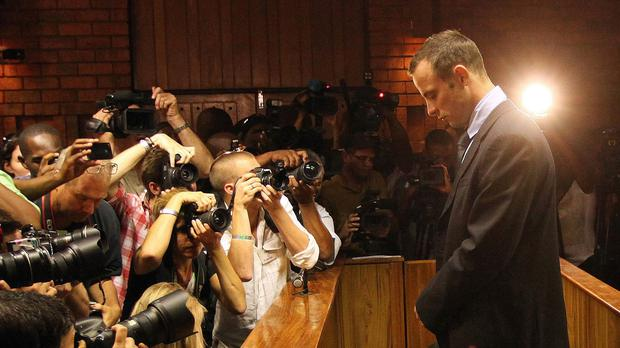 Oscar Pistorius is awaiting a court ruling on whether his conviction of culpable homicide should be replaced with the initial and more serious charge of murder (AP)