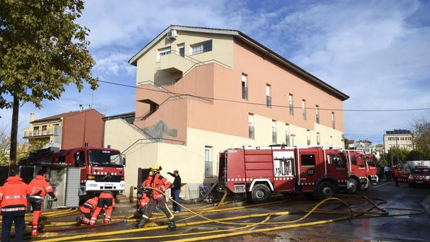 Emergency workers at the scene where five residents were rescued after the rain engulfed a ground floor of the building next to the Sio River in the town of Agramunt (PA)