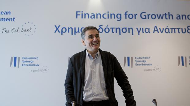 Greek finance minister Euclid Tsakalotos arrives for a press conference in Athens (AP)
