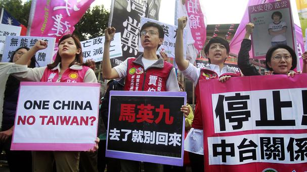 Opposition protesters in Taipei shout slogans opposing the planned meeting of President Ma Ying-jeou with his Chinese counterpart Xi Jinping (AP)
