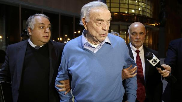 Jose Maria Marin, centre, leaves court in Brooklyn, New York (AP)