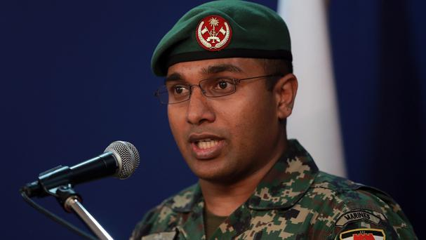 Captain Ali Ihusaan speaks to the media after an explosive device was discovered near the president's official residence. (AP)