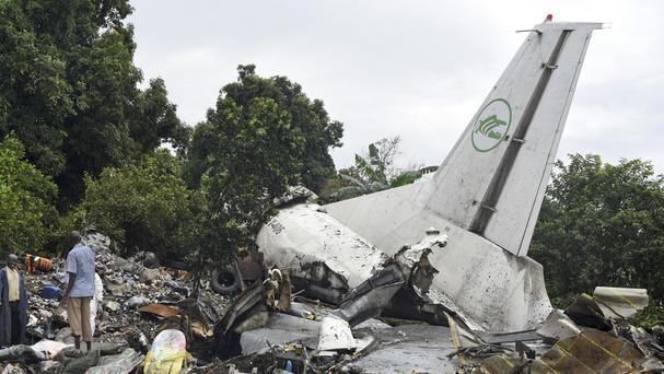Responders pick through the wreckage of a cargo plane which crashed in the capital Juba