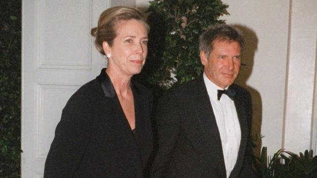 Melissa Mathison and then husband Harrison Ford pictured arriving at a White House dinner in 1998 (AP)