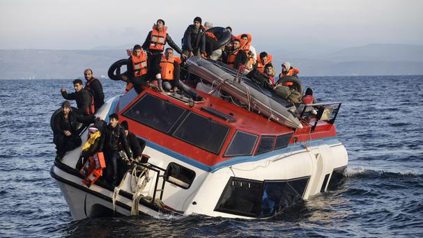 Refugees and migrants on a heavily listing boat travelling to Greece from the Turkish coast. (AP)