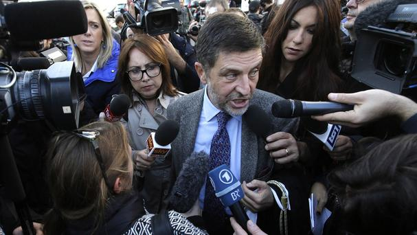 Massimo Carminati's lawyer Giosue Bruno Naso speaks to reporters as he arrives at a court in Rome (AP)