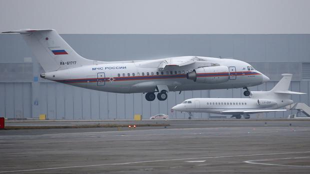 A Russian Ministry for Emergency Situations plane carrying the bodies of victims of a plane crash, lands at Pulkovo airport outside St Petersburg. (AP)