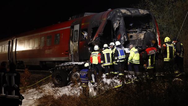 The burned-out cab of the train which collided with a lorry near Freihung (AP)
