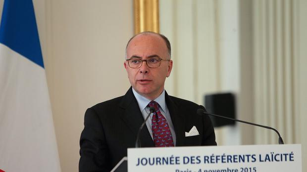 Bernard Cazeneuve said France is to reinstate border controls for a month around a major UN climate conference (AP)