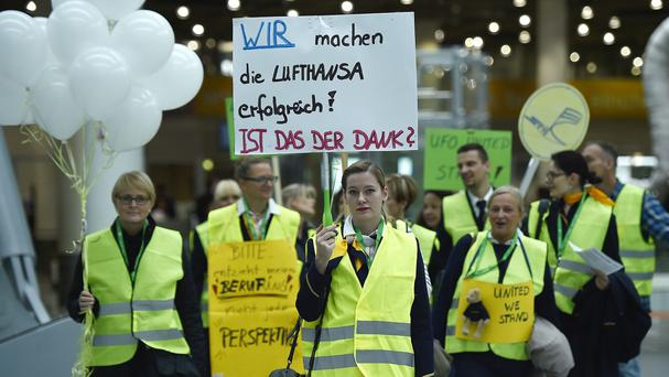 Lufthansa plans to cancel numerous outgoing flights from Frankfurt and Duesseldorf airports due to a cabin crew strike (AP)