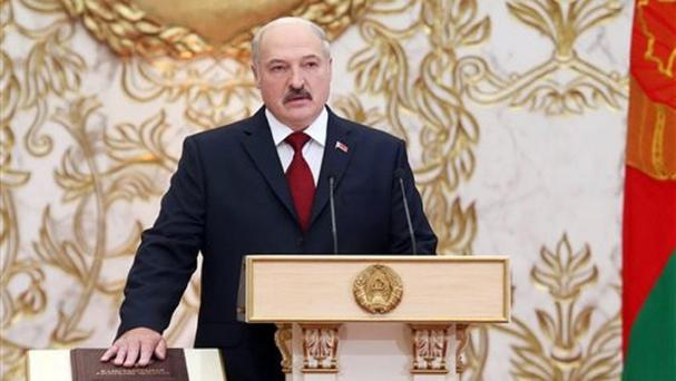 Belarusian president Alexander Lukashenko takes his oath of office during his inauguration ceremony in Minsk (Nikolai Petrov, BELTA via AP)
