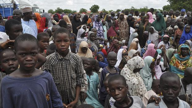 Civilians who fled their homes following an attack by Islamist militants in Bama, take refuge at a school in Maiduguri, Nigeria (AP)