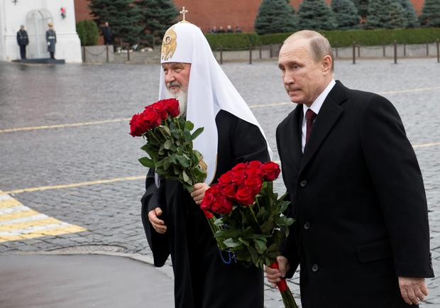 Vladimir Putin lays flowers at Red Square in Moscow. Photo: AFP/Getty Images