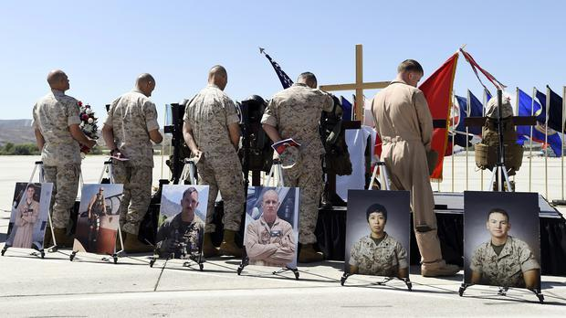 US Marines pay their respects after a memorial service at Camp Pendleton, California, to six comrades killed in the helicopter crash in Nepal (AP)