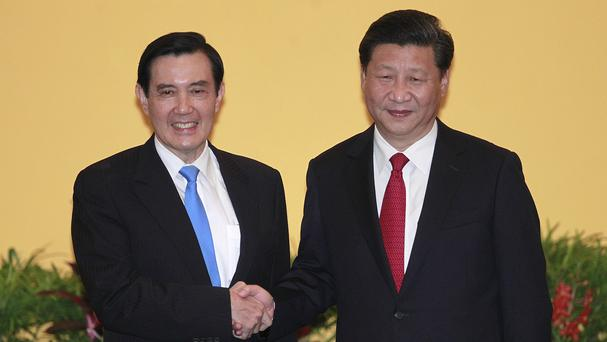 Taiwan's president Ma Ying-jeou, left, and China's president Xi Jinping shake hands (AP)