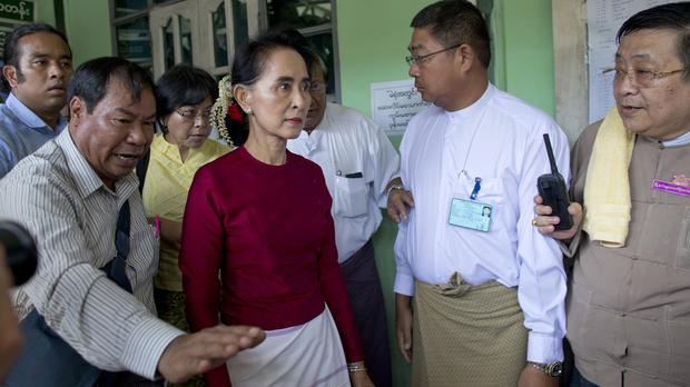 Burma's National League for Democracy party leader Aung San Suu Kyi arrives to vote in Rangoon (AP)