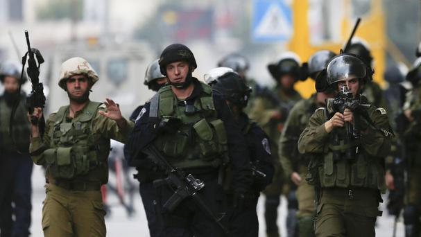 Israeli security forces shot dead a Palestinian man who drove his car into a group of Israelis
