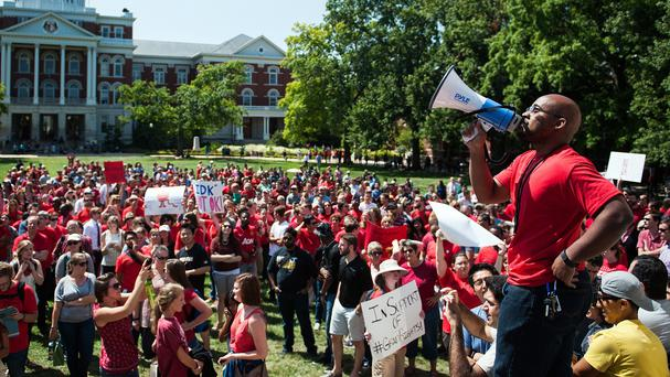 Hunger-strike student Jonathan Butler addresses protesters at a 'day of action' demonstration in August (Columbia Daily Tribune /AP)