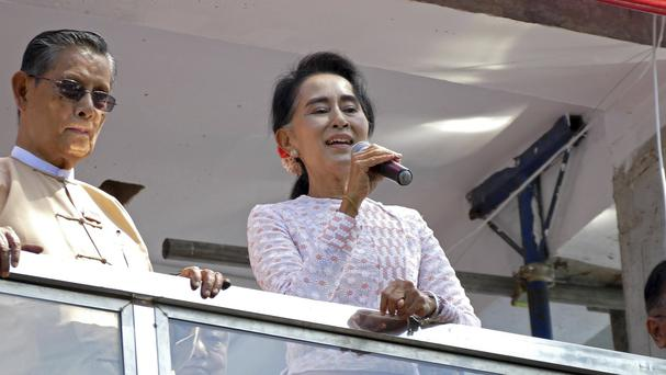 Opposition leader Aung San Suu Kyi delivers a speech (AP)