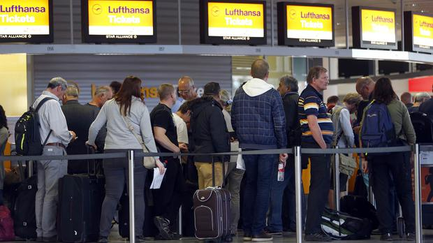 Passengers wait for information at a Lufthansa counter at Munich airport in Germany as cabin crew stage strike action (AP)