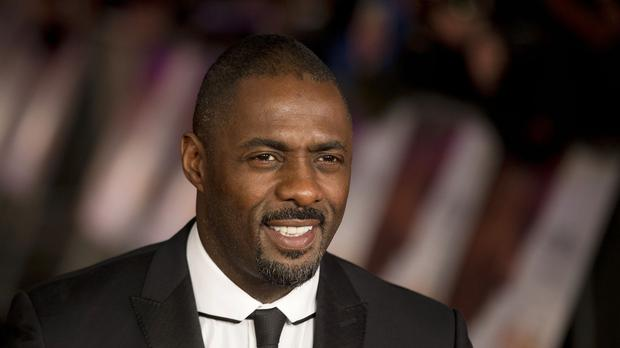 Idris Elba will open for Madonna when her Rebel Heart tour reaches Berlin (AP)