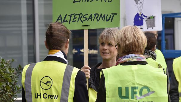 Lufthansa cabin crew protest during a strike at Dusseldorf airport in Germany (AP)
