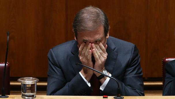 Portugal's now-ousted prime minister Pedro Passos Coelho reacts during a debate of the government's policy programme at the parliament in Lisbon (AP)