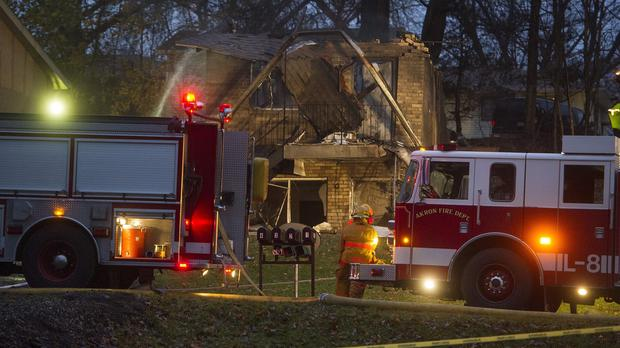 Firefighters work at the scene where a small business jet crashed into an apartment building in Ohio (AP)