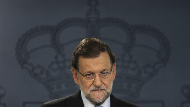 Spain's prime minister Mariano Rajoy listens to a question during a news conference at the Moncloa Palace in Madrid (AP)