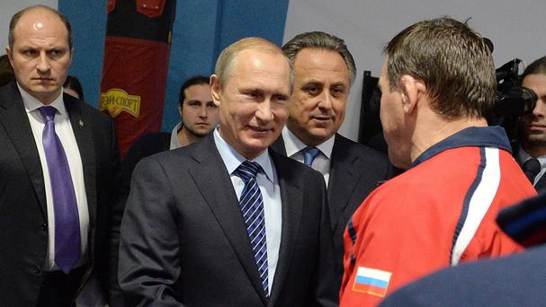 Vladimir Putin during a visit a sports centre in Sochi (RIA-Novosti, Kremlin Pool/AP)