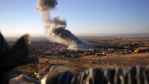 Smoke believed to be from an airstrike billows over the northern Iraqi town of Sinjar (AP)