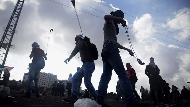 Palestinian protesters clash with Israeli security forces in the West Bank (AP)