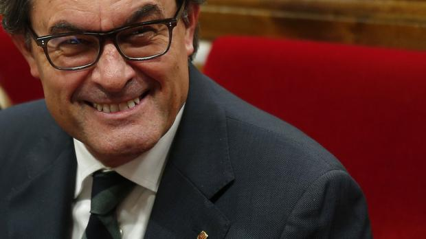 Catalan regional acting president Artur Mas lost the first vote on Tuesday (AP)