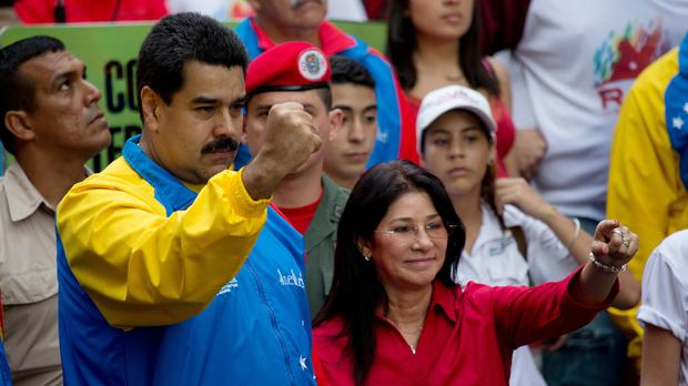 Venezuelan president Nicolas Maduro and first lady Cilia Flores greet supporters in Caracas (AP)