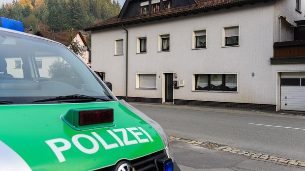 A police car is parked in front of a house in Wallenfels, Germany, where police found the bodies of multiple babies (Nicolas Armer/dpa via AP)