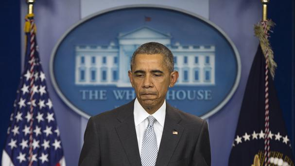 President Barack Obama pauses as he speaks about attacks in Paris from the briefing room of the White House (AP)