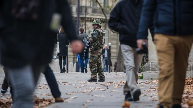 A soldier patrols outside the French National Assembly in Paris (AP)