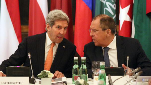 US Secretary of State John Kerry (left) talks with Russian foreign minister Sergey Lavrov (AP)