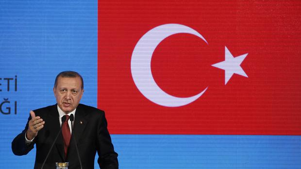 Turkish president Recep Tayyip Erdogan speaks to the media in Istanbul (AP)
