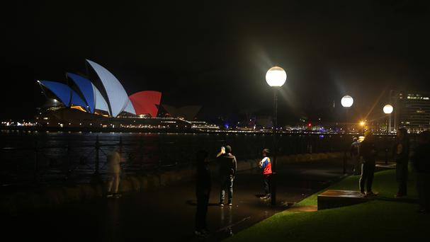Sydney Opera House is lit in the colours of the French flag (AP)