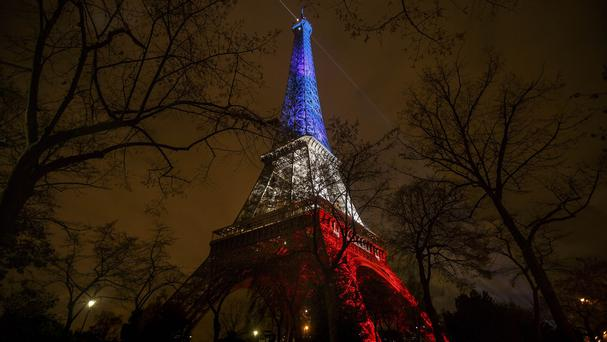 The Eiffel Tower illuminated in the French colours in honour of the victims of the attacks (AP)
