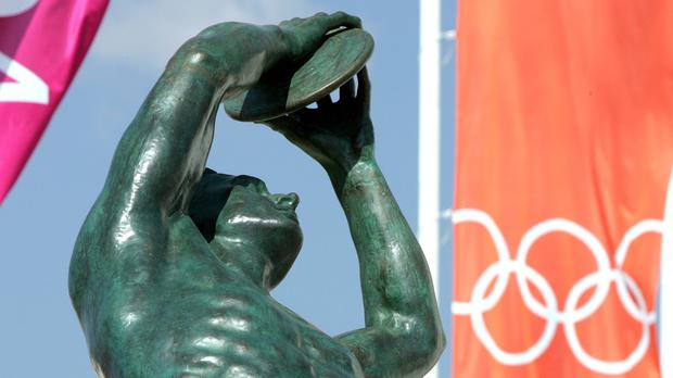 A discus thrower statue welcomes athletes to the Athens games in 2004