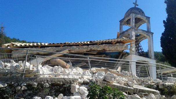 A Greek Orthodox church is seen destroyed after a morning earthquake at the village of Athani on the western Greek island of Lefkada (Lefkdadanews.com via AP)