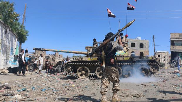 Tribal fighters prepare to take their positions on a street during fighting with Shiite rebels known as Houthis, in Taiz, Yemen (AP)