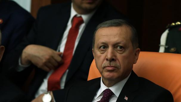 Turkish president Recep Tayyip Erdogan looks at the new parliament (AP)