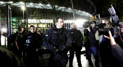 Police officers at the entrance to the stadium in Hannover