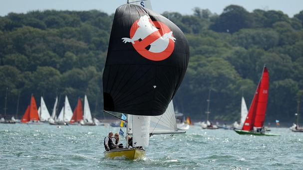 A Swallow class boat with a Ghostbusters-themed spinnaker during this year's Aberdeen Asset Management Cowes Week