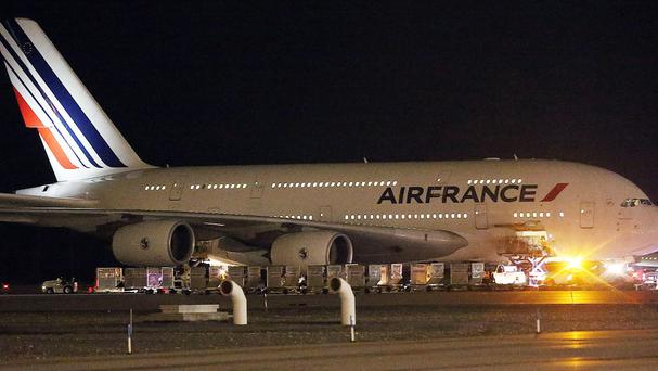 Emergency vehicles surround the Air France plane at Salt Lake City International Airport (The Deseret News/AP)