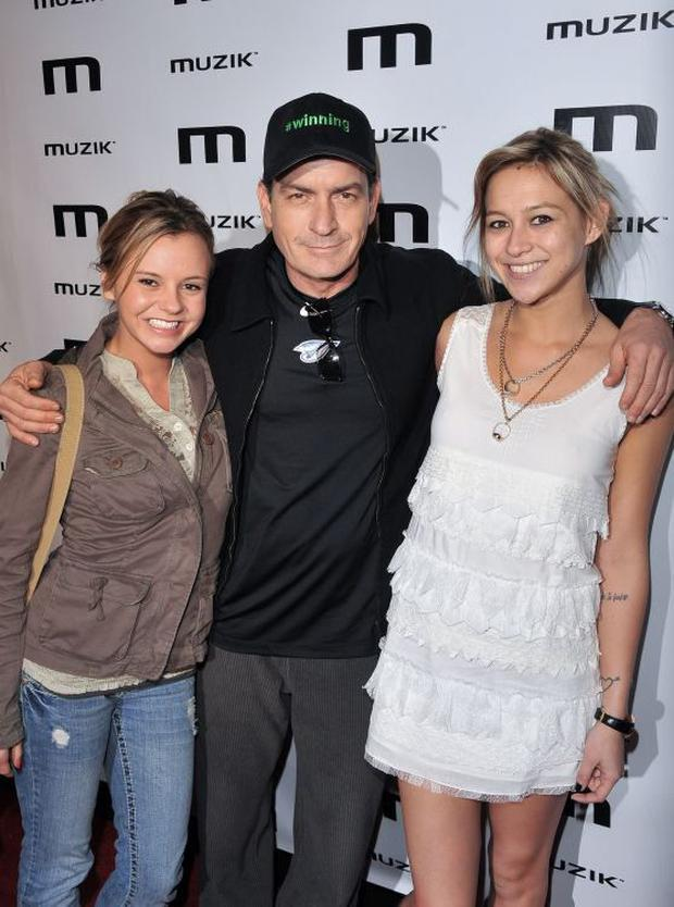 Charlie Sheen with ex-lovers Bree Olson and Natalie Kenly in 2011