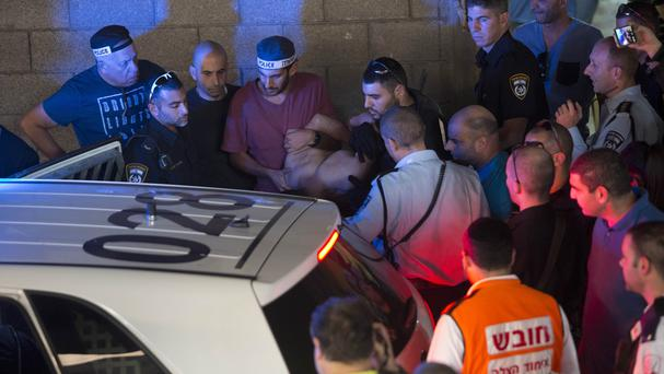 Israeli police arrest a Palestinian following the stabbing. (AP)